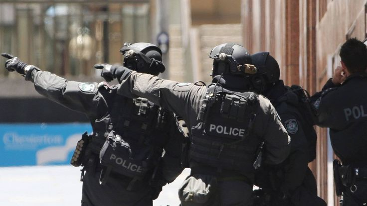 Sydney cafe siege: Police have stormed the cafe where the gunman has been holding a number of people hostage, AP and Reuters news agencies say.