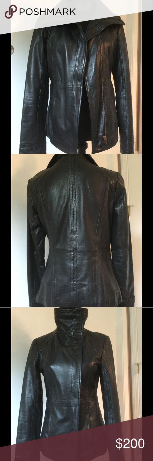 Ted Baker Leather Jacket Slight asymmetrical zip thick soft leather jacket.  Hits just below hip.  Beautiful floral print lining.  Rose gold zipper. Excellent condition. Ted Baker London Jackets & Coats