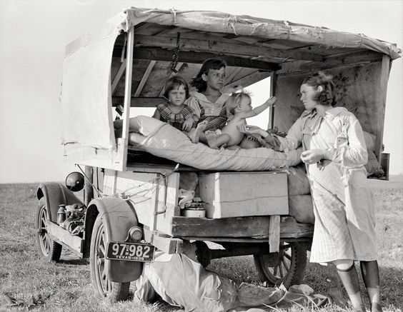"""Shorpy Historical Photo Archive:  August 1936. """"Family between Dallas and Austin. The people have left their home and connections in South Texas, and hope to reach the Arkansas Delta for work in the cotton fields. Penniless people. No food and three gallons of gas in the tank. The father is trying to repair a tire. Three children. Father says, 'It's tough but life's tough anyway you take it.'"""" Medium-format nitrate negative by Dorothea Lange for the Resettlement Administration."""