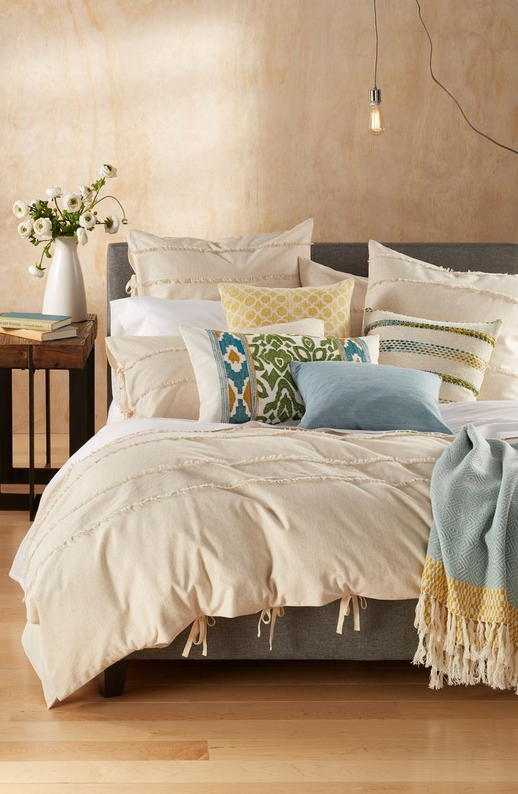 Creating a shabby-chic look in the bedroom with this classic duvet cover featuring sweet fringe and soft colors.