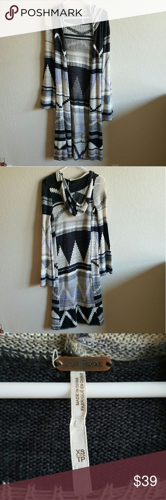 Free People Duster Aztec Print Hooded XS-M Free People hooded duster in shades of cream, gray, and black. Looks really cute with jeans and boots! Size XS, but runs loose so it could fit up to a medium. Bell shaped sleeves, 43.5 inches long. Some pilling on the sleeves as shown, but very good condition overall, only worn once or twice. Thanks for viewing! Free People Sweaters