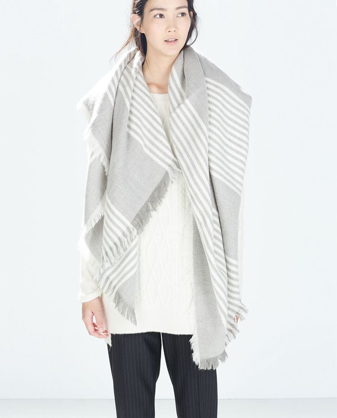 $19.95 Striped scarf with tassel detail.