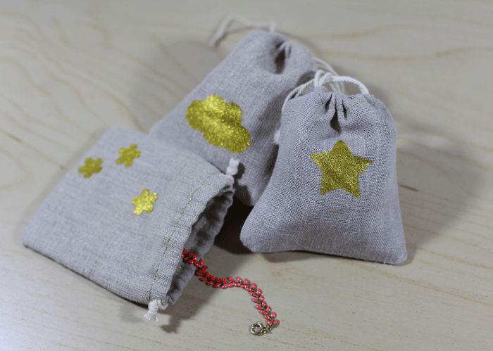 Un tuto pas à pas pour réaliser de jolis petits sacs cadeaux. Lin et doré, ces petits sachets feront sans aucun doute leur effet!