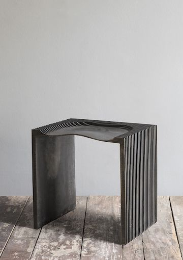 """Sand casted stool"" by Jan Janssen Werken. Cast iron/waxed finish."