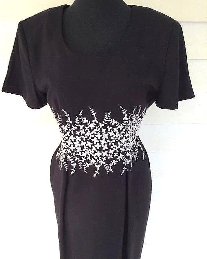 """Misses DJ International dress! Black with white floral waist. May show slight washing dry clean wear, lots of wear left. Shoulder pads. Underarm to underarm laying flat 18"""". 