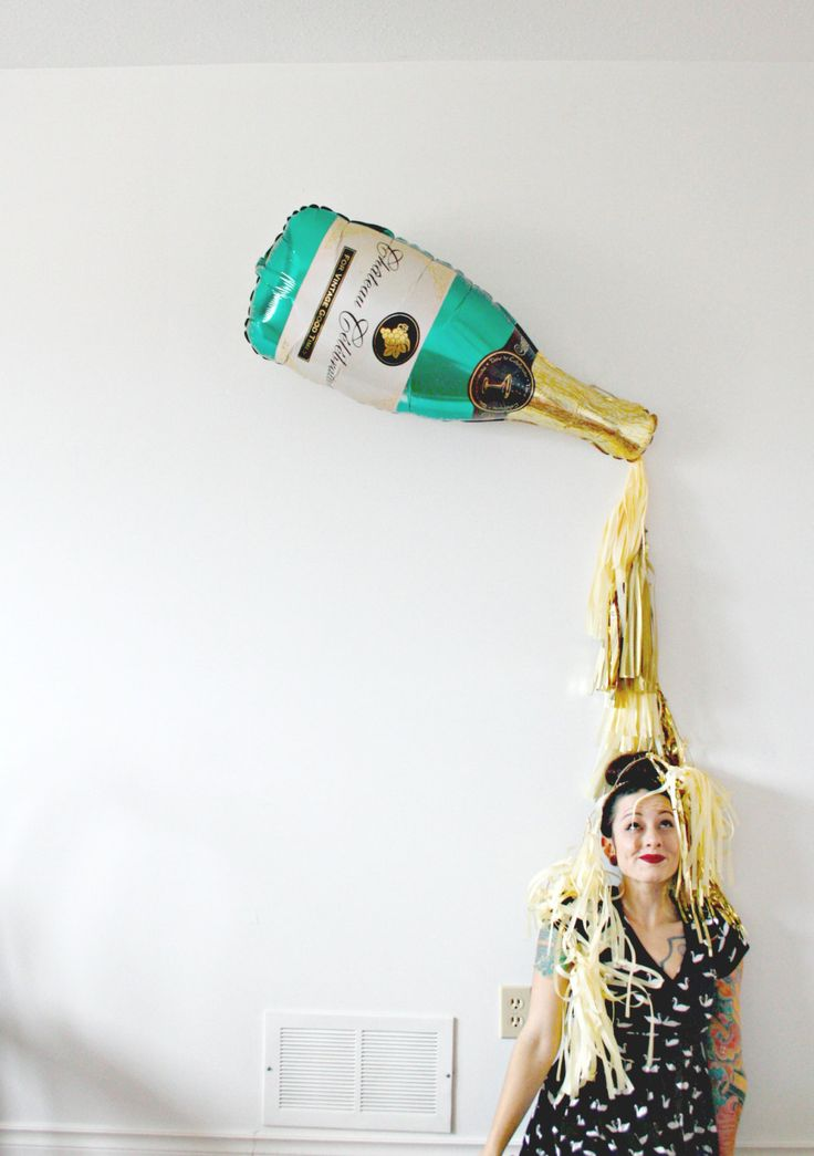 Pop Clink Fizz! 10. 9. 8. 7. 6. 5. 4. 3. 2. 1 - HAPPY NEW YEAR! Ring in 2017 in style with this super amazing champagne bottle prop - great for a photobooth or behind your buffet set up! this listing includes: Giant 36 Inch Mylar Champagne Bottle Balloon (can be filled with air and hung,