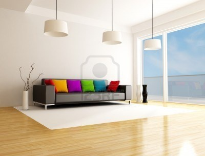 black sofa with colored cushion in a minimalist lounge Stock Photo