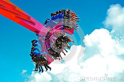riders on the exiting flash ride at ocean park hong kong. rising over 22 meter high, it whiz around the riders so fast at a dizzying top speed of 60 km per hour. heck of a ride that mercilessly rotates and push the riders to their limits.