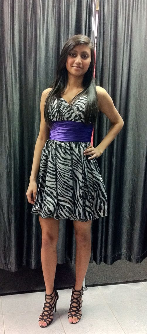 Happy customer showing off her beautiful short zebra print  dress from Nina's Collection Boutique.