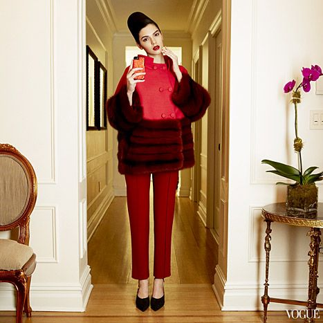 In this look from Carolina Herrera's collection, Jenner poses in the designer's red coat with fur-trimmed sleeves and bottom and deep red pants. Her hair is fashioned into a high bouffant and she wears a deep-red lip.  Jenner also modeled looks from Vera Wang, Michael Kors, Tory Burch, The Row, Prabal Gurung, Calvin Klein Collection, and Tommy Hilfiger.