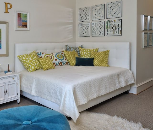 Corner daybed - and love the idea of recovering my black ottoman with a bright blue velvet or similar..
