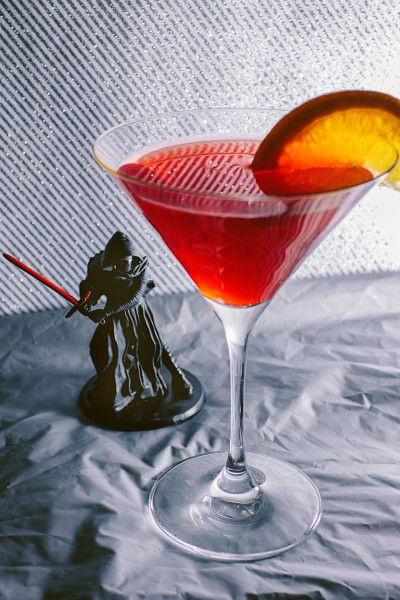 KYLO REN-TINI Are you still mourning the death of Darth Vader? Well don't worry — so is Kylo Ren. In fact, the only thing more bitter than him is this cocktail as red as his crossguard lightsaber. Star Wars Inspired Drinks - #StarWarsDay Star Wars Recipes