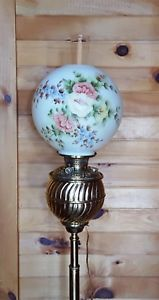 """This """"Bradley and Hubbard"""" antique lamp is in excellent condition. It has been converted from oil to electricity and has the ability to use a tri-light bulb. It could easily be converted back to oil as all parts are in very good condition, including the tank. This lamp is extendable from 51"""" to 66.5"""" making it ideal to use as a piano lamp or a floor lamp. The 11"""" shade is lovely, hand painted with pastel  flowers. I do not know if this is the original shade.  Please see all photos for…"""
