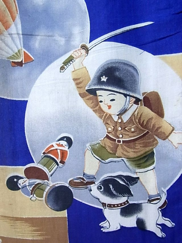 Detail of a child's kimono showing a boy in army uniform striking at  his toy soldiers, Great Britain in red, and the U.S in blue.