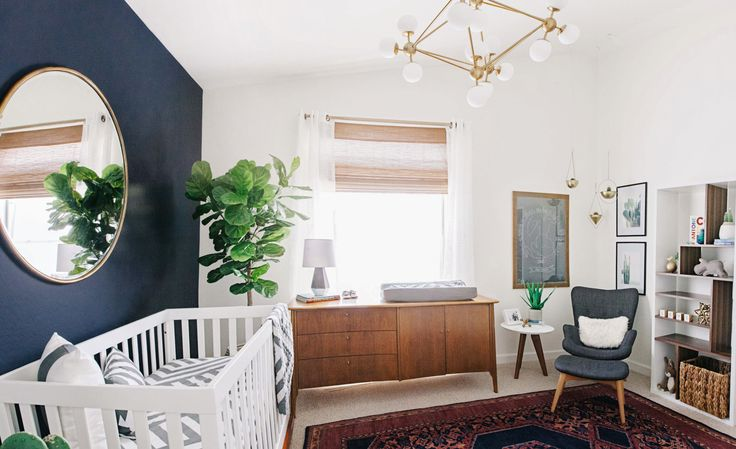 Alexandra Evjen's son's nursery blends mid-century modern style with southwestern flair into a sophisticated yet masculine design for her son.