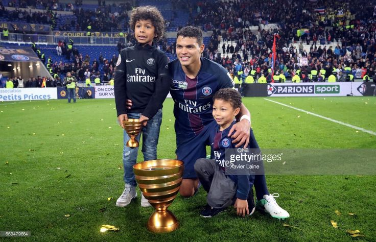 Captain Thiago Silva of Paris Saint-Germain hold the trophy with his sons after the French League Cup Final match between Paris Saint-Germain and AS Monaco at Parc Olympique on Japril 01, 2017 in Lyon, France.
