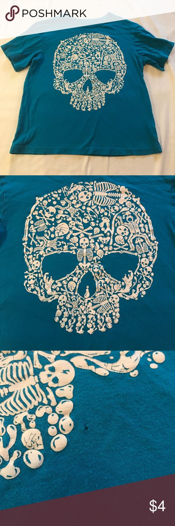 Children's Place skull tee Bright blue skull tee from Children's Place! This was very much loved by my son, he is just too big for it now. There is two small issues with it. (Photos shown) perhaps someone who's good with a needle, thread, and patience lol can work on this baby! Shirt reads: size M 7/8 100% cotton Children's Place Shirts & Tops Tees - Short Sleeve