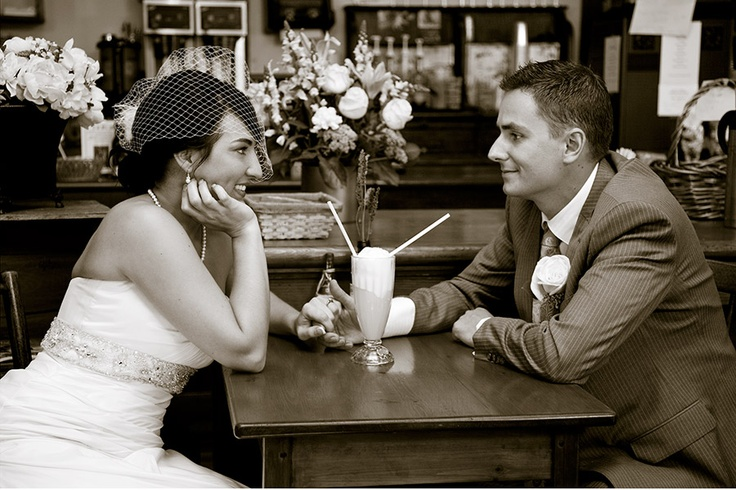 Vintage wedding, Bride and Groom share a soda