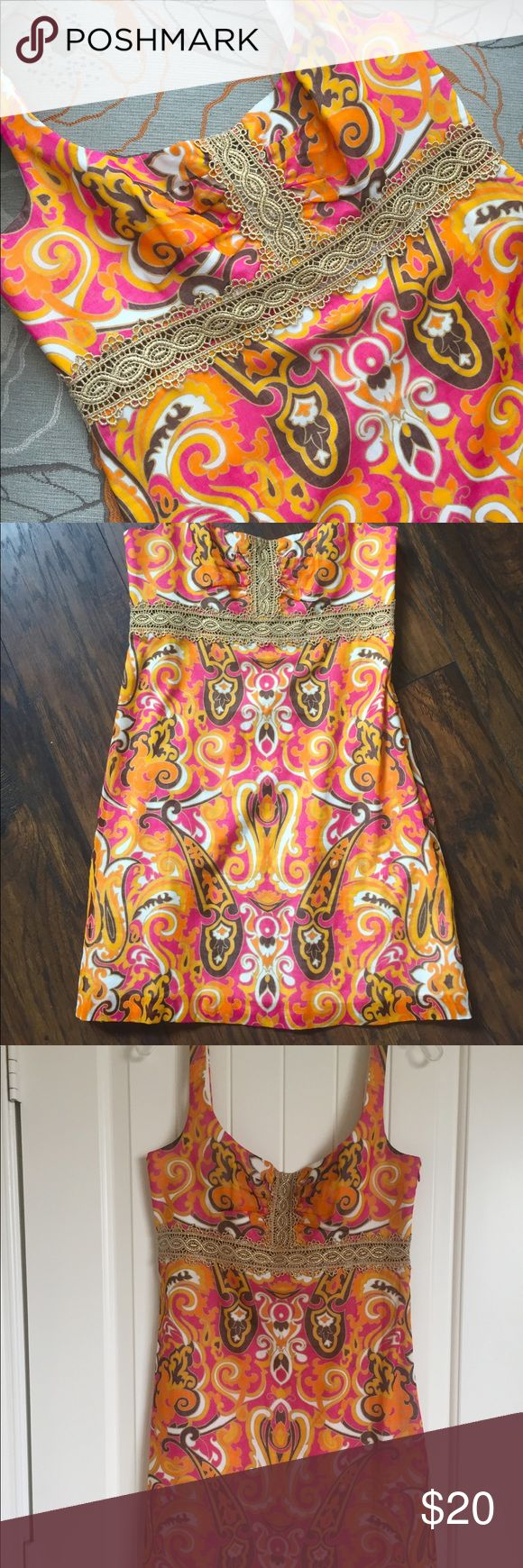 Milly Minidress Short mini dress made by Milly. Colorful bright pinks, oranges, and browns interplay with each other like a Moroccan dance, Gold accent along the front and back bra line. Milly Dresses Mini