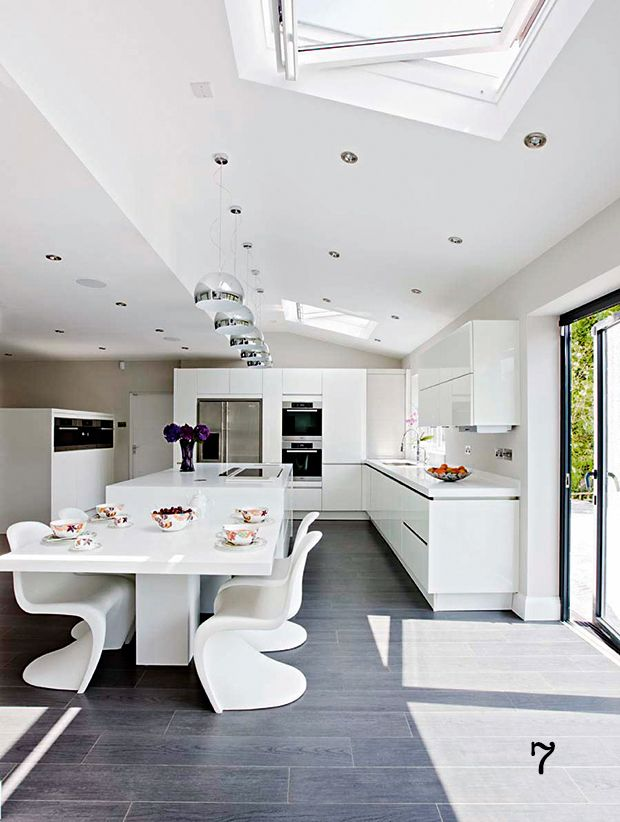 natural light filled kitchen diner with high gloss cabinets from Neil Lerner