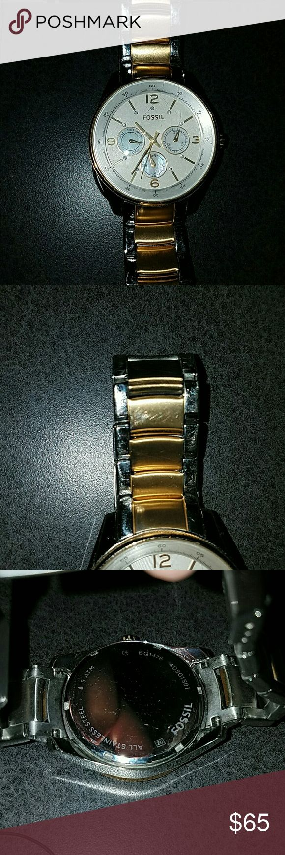 Fossil watch Two tone fossil watch, gold and silver. White face. In great condition. A few small scratches shown on the photos above. Comes with the box. Fossil Accessories Watches