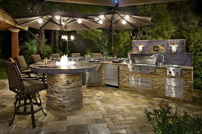 Tropical Backyard Patio Ideas with Modern Outdoor Kitchen and Outdoor Table Umbrella Design