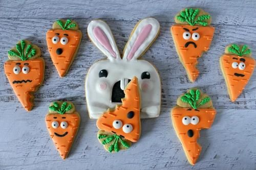 Killer Bunny Cookies |  It is perfect for home bakers with a sense of humor.  This silly portrayal of the Easter bunny devouring carrots are guaranteed to make the kids laugh.  You will want to bake and decorate these cookies the night before to allow them plenty of time to set before putting them on the Easter table. @clairellynrose