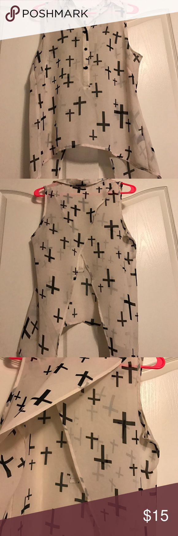 White sleeveless collared shirt with black crosses White sleeveless collared shirt with black crosses- buttons on front and the back hangs down with the sides crossing over each other Charlotte Russe Tops