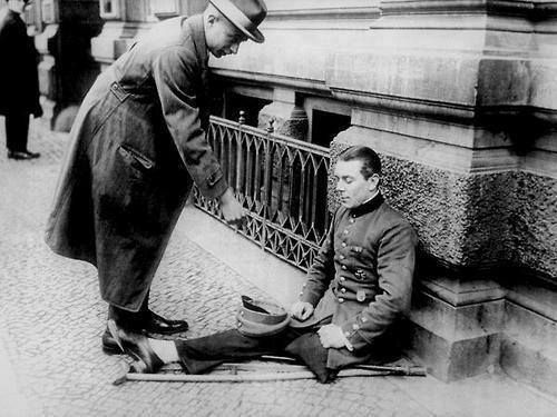 Sadly nothing has changed. 1923 : A disabled First World War veteran begging on the streets of Berlin Weimar Republic(Germany)  He is an Iron Cross recipient. With the state of hyperinflation in the German economy in 1923 that was probably a 10000 mark coin he's handing him.