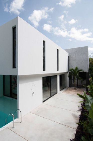 Fachada lateral de casa minimalista