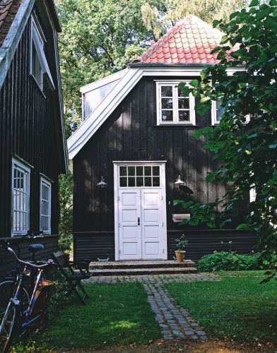 Black house with white woodwork and doors. <3