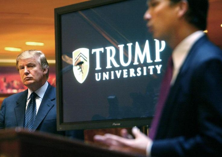 In this May 23, 2005 file photo, Donald Trump, left, listened as Michael Sexton introduced him at a news conference in New York where he announced the establishment of Trump University. The New York Attorney General announced a $25 million settlement in the Trump University case on November 18, 2016, two months before Trump was to be sworn in as President of the United States.