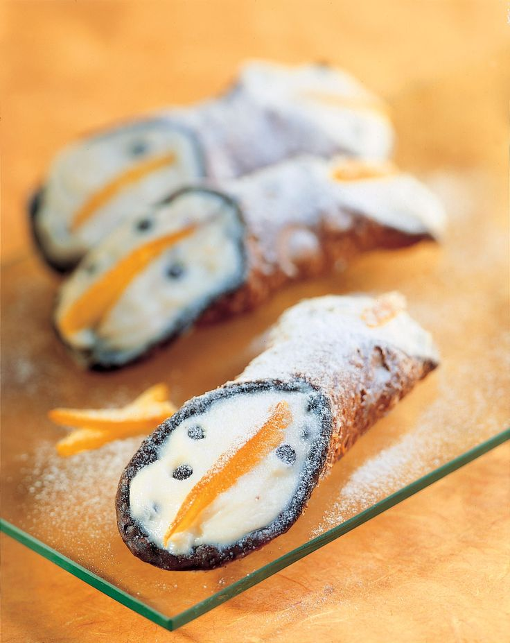 Cannoli is the ultimate Sicilian dessert.  Bindi Cannoli features a chocolate rimmed pastry shell, filled with sweetened ricotta cream studded with candies fruit and chocolate chips.