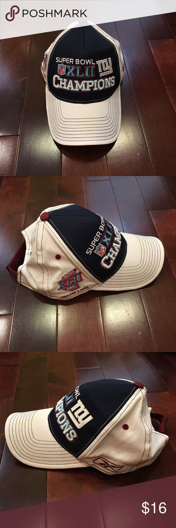 New York Giants Superbowl Champions Hat Good condition!  Has minor spots on the front top brim.  Adjustable Velcro. Reebok Accessories Hats
