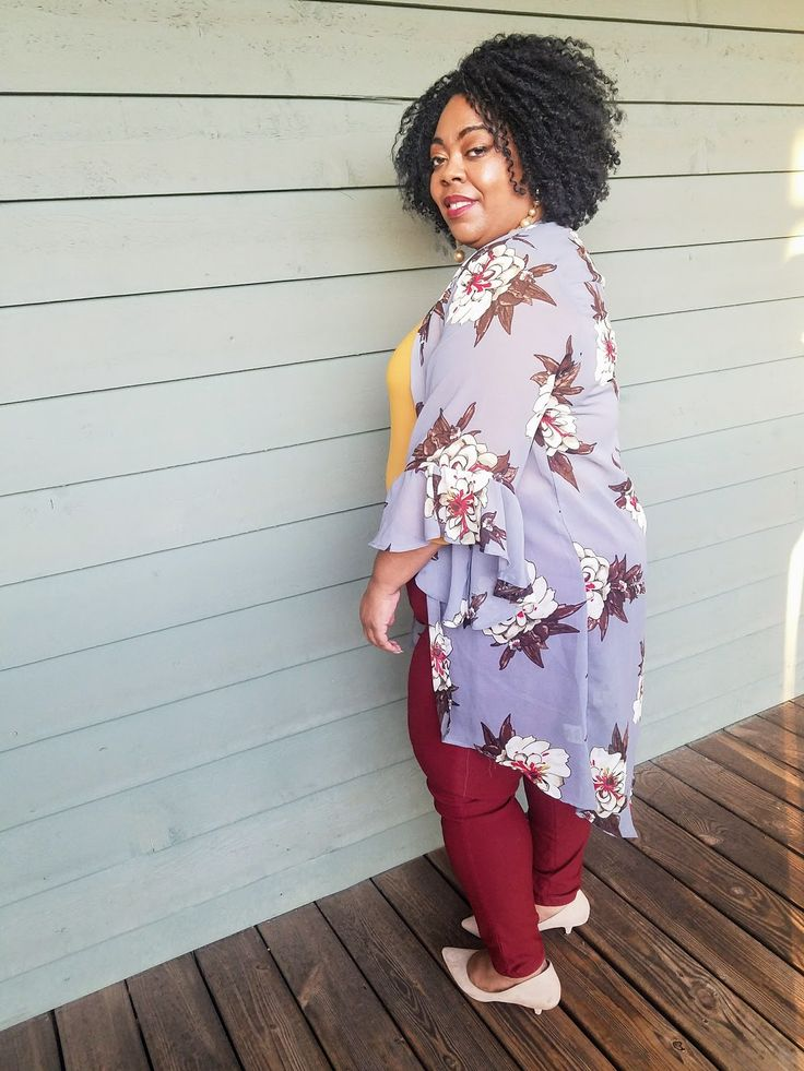 Plus blogger wearing sheer floral print duster, mustard colored top, maroon jeggings and kitten heels.