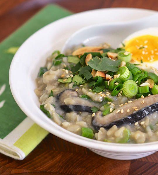 Congee, jook, okayu. Asian-style rice porridge has many names and countless variations, but in every instance it is a simple, comforting dish for breakfast or any time of day. This extra nutritious version includes brown rice, shiitake mushrooms, handfuls of greens, and warming ginger.