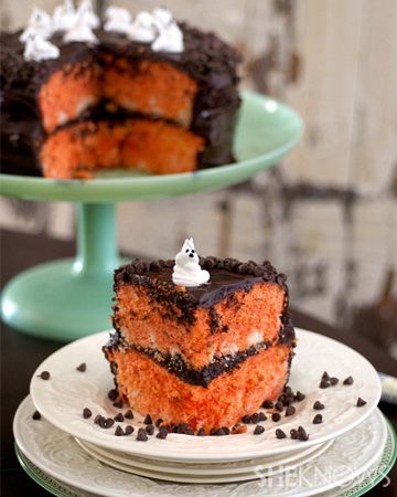 Halloween surprise cake | Marbled Orange with Dark dark dark chocolate frosting and chips. With cute ghosts on top.