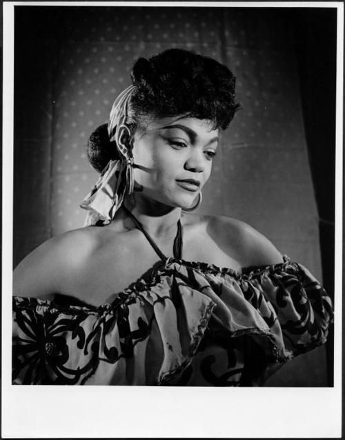 Eartha Kitt in 1948 as a Katherine Dunham dancer performing in Street scene, part of Motivos, choreographed by Ms. Dunham.  Photo: Roger Wood, New York Public Library for the Performing Arts.