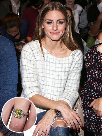 The Most Unbelievable Engagement Rings of 2014 | OLIVIA PALERMO & JOHANNES HUEBL | Of course the fashionista wasn't going to wear just any old ring – her model beau proposed with a cushion-cut yellow diamond over the New Year. And of course, she didn't wear just any old wedding dress, either: Hers was a custom shorts and sweater set by Carolina Herrera.