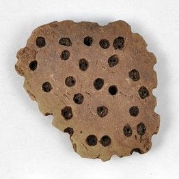 A fragment of a sieve that researchers say were used as cheese strainers. Researchers  said they found the earliest known chemical evidence of cheese-making, based on the analysis of milk-fat residues in pottery dating back about 7,200 years.