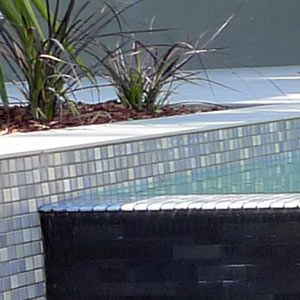 See more Snow Blend glass mosaics used to tile Australian pools
