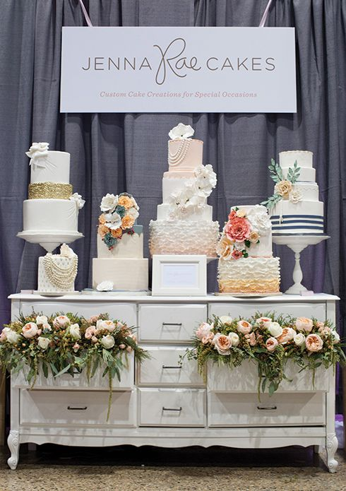 dessert table idea bridal show booth its full of cakes but its show stopping love the flowers coming out of the drawers