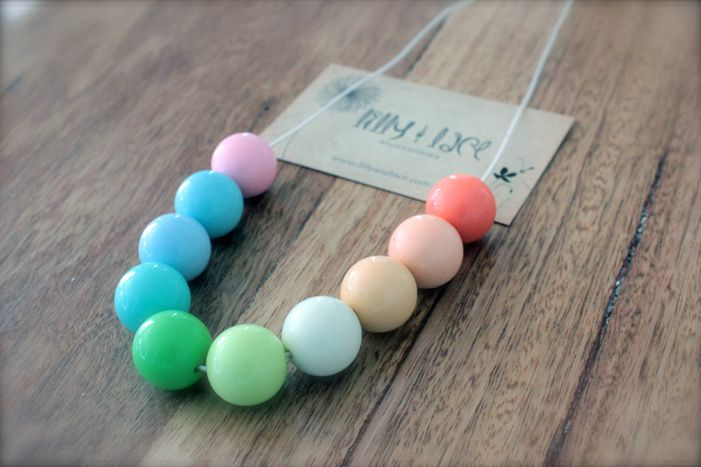 A rainbow of chunky acrylic beads sit on a simple cotton necklace. One size fits all, simply pull over the head.  We recommend kids jewellery be given to girls over 3 years of age.