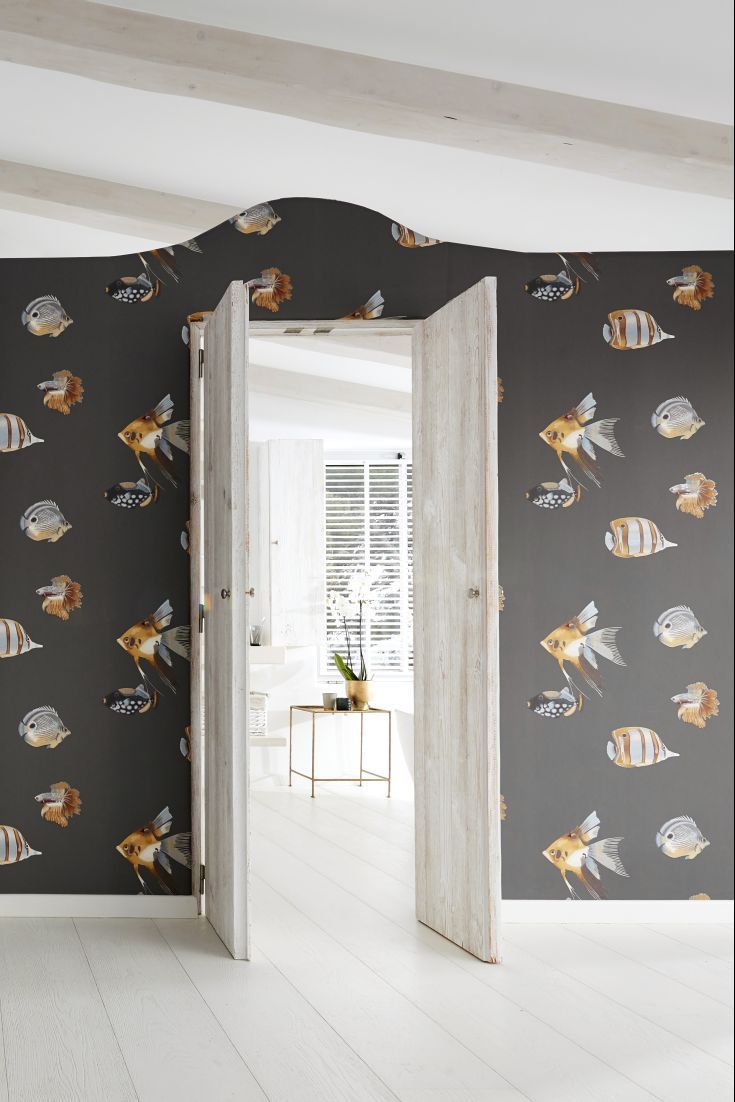 The stunning Kamanu wallpaper design by Harlequin featuring a variety of tropical fish.