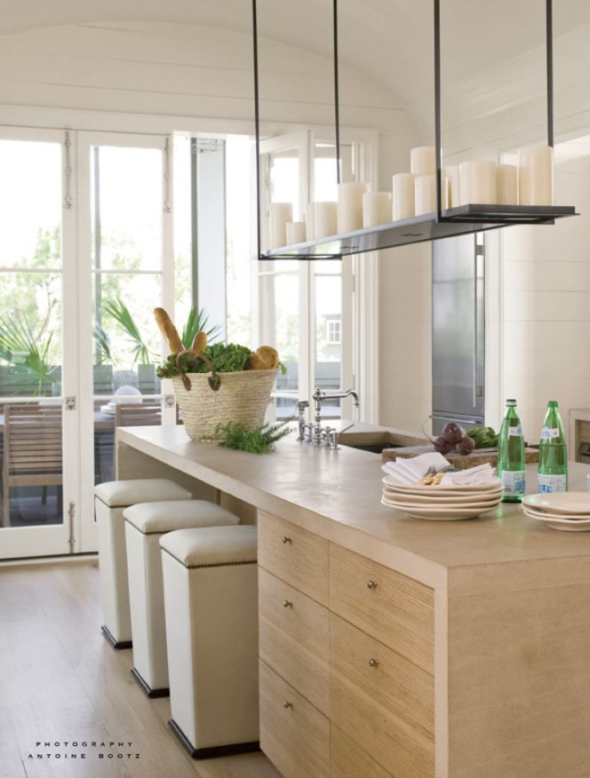 Kitchen w/ limestone countertop; chandelier is Kevin Reilley for Holly Hunt; Bates Corkern