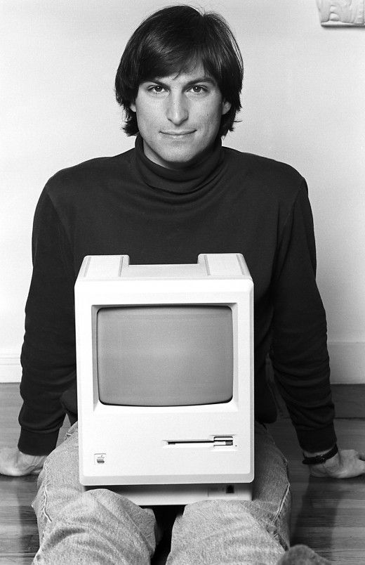 The young Steve Jobs with an Apple desktop on his lap...