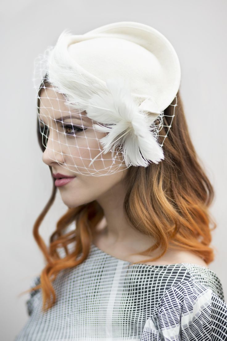 Vintage style felt hat wih feather trim and flower, finished with birdcage veil. Model make up, lined eyes, dip dyed hair. https://www.etsy.com/uk/listing/191513887/vintage-style-felt-hat-with-birdcage http://www.maggiemowbraymillinery.com/bridal-hats/
