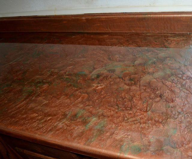 Resurfacing formica countertop with epoxy. Good tutorial and serious option for the mudroom/craft area counter! Many colors. *grin*