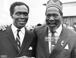 The first Prime Minister of Kenya and former Mau-Mau leader Jomo Kenyatta (right) greeting the Ugandan Prime Minister Milton Obote at a meeting in Nairobi.