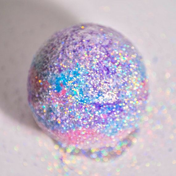 This bath bomb is inspired by non other than unicorns themselves. Its multi-color layers moisturize and relax. Unicorn Blood smells heavenly, exactly like you would imagine unicorns would smell like. This bath bomb is also for all my holo-sexuals out there, as its been covered in a thick layer of holographic, environmentally friendly, cosmetic grade glitter. The colorful layers give off a pinkish foam, while turning the water a vibrant violet purple. Ingredients: Citric acid, Sodium…